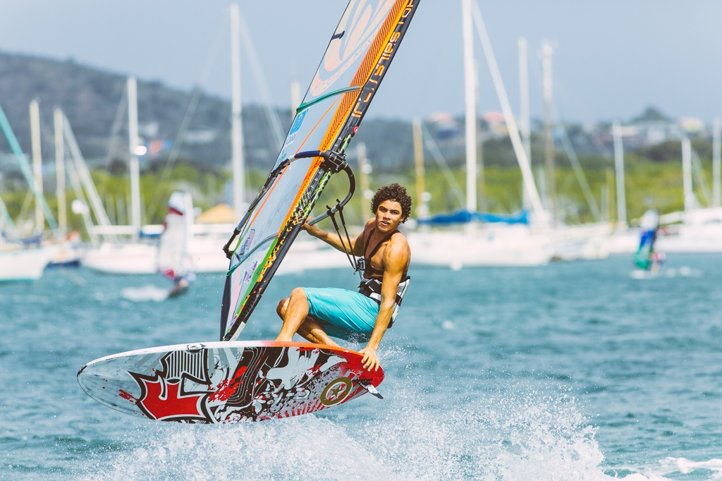 Onehanded jump windsurfing Spanish Waters