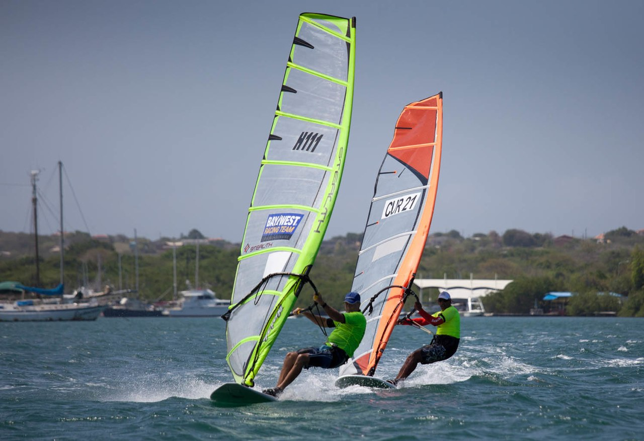Windsurfers racing over the water